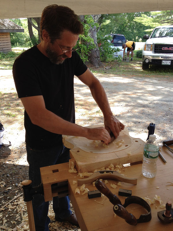 Peter Galbert uses a travisher to refine a chair seat