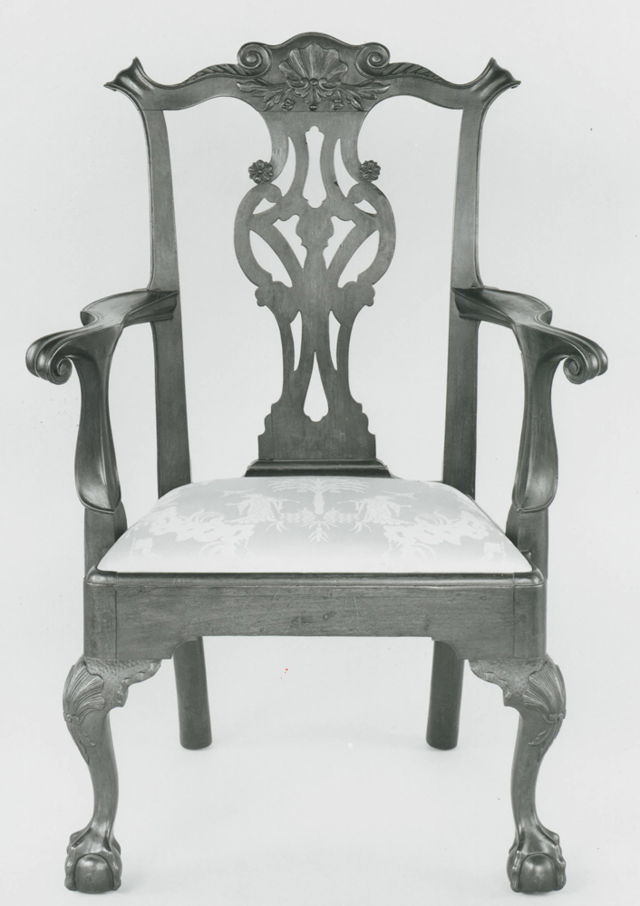 A Philadelphia ball and claw foot arm chair.