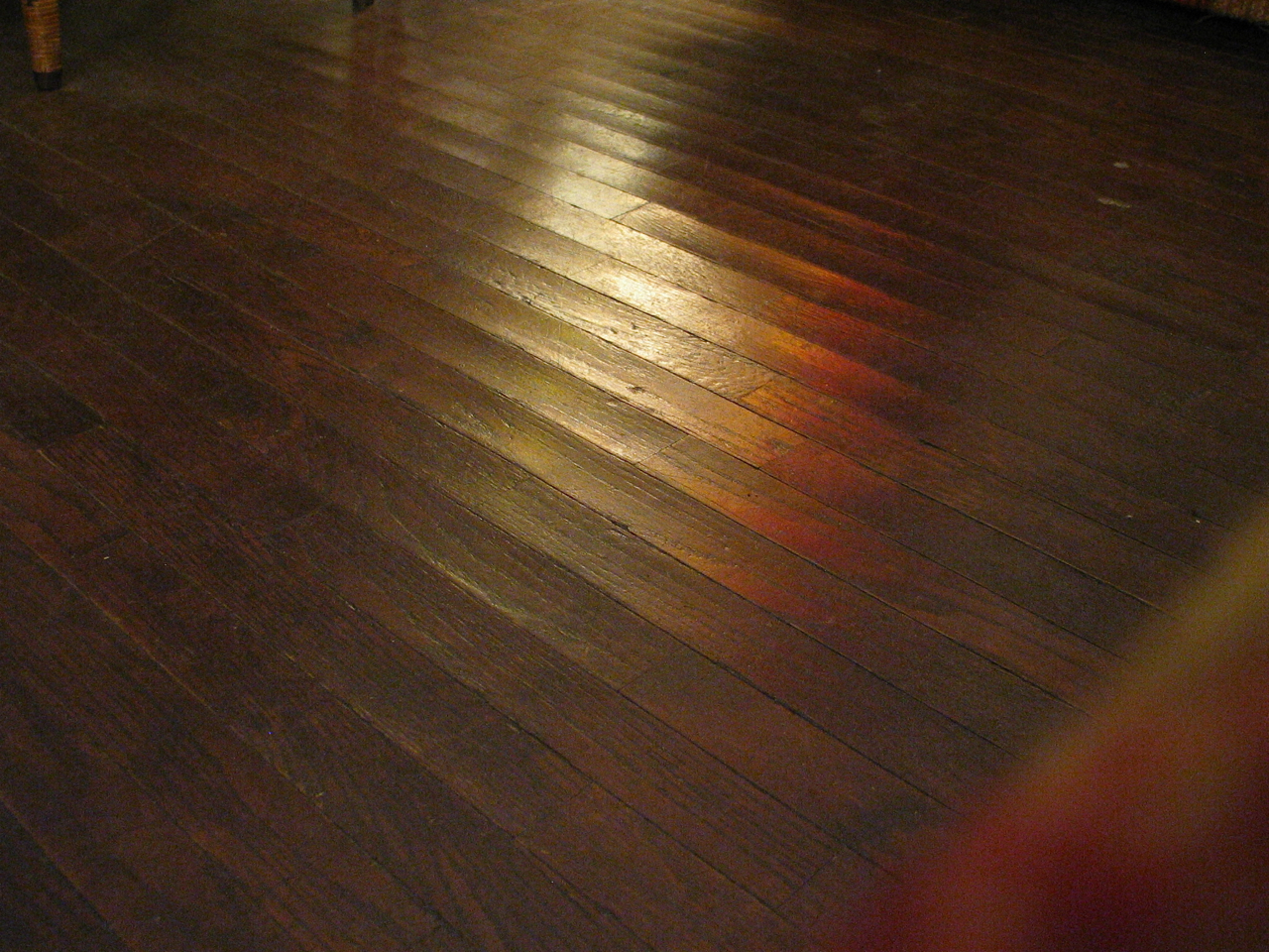 Water warps wood opposite from what you may think for Hardwood floors warping
