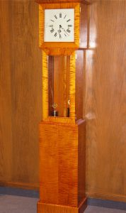 This curly maple tall-case clock was made and finished by a friend of mine