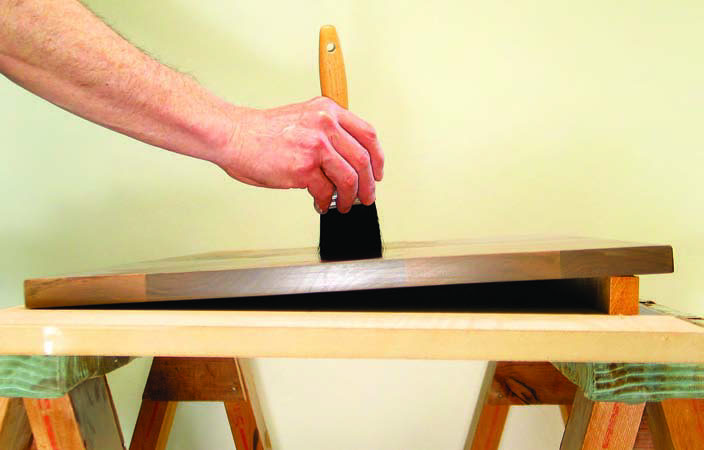 Angle the board before brushing a polyurethane finish for better results? That's a myth.