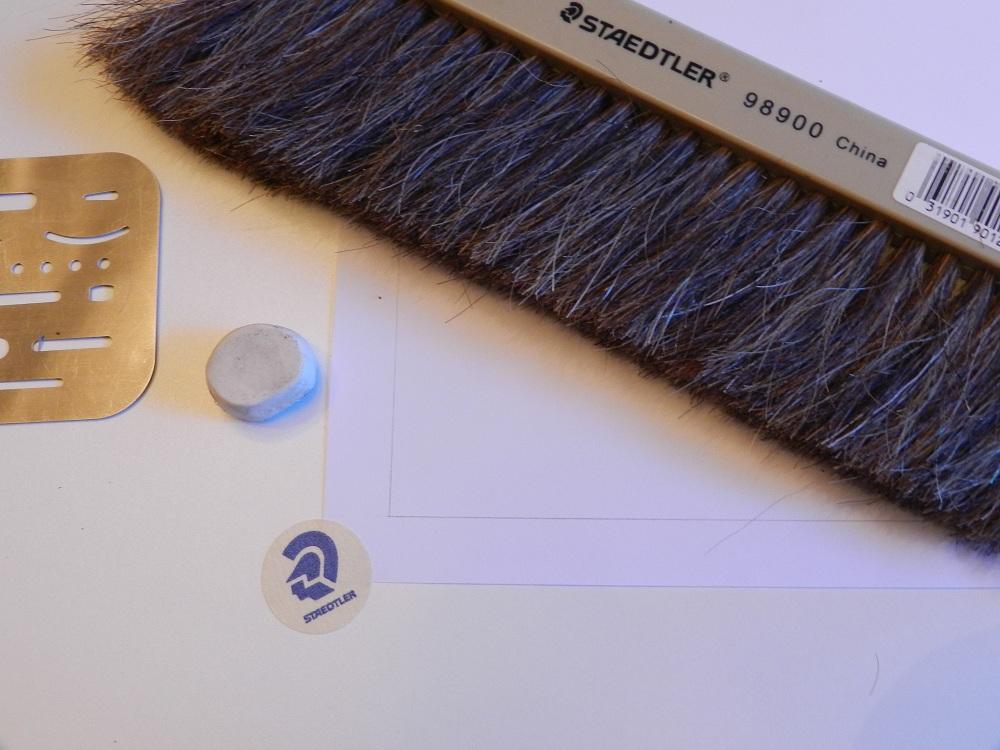 Hand drafting brush and eraser shield