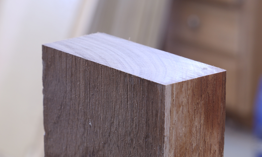 Walnut viewed at an angle showing smooth, clean cut.