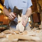 Green woodworking begins with the most basic of tools and material. Jarrod StoneDahl cuts into a new spoon, above.