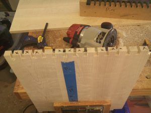 Building a hope chest with dovetailed joints is easier with this jig.