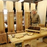 That's me in my shop with reproduction clock cases based on accurate photographs I've taken.