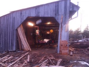 The sawmill machine is housed within this lovely sawmill barn