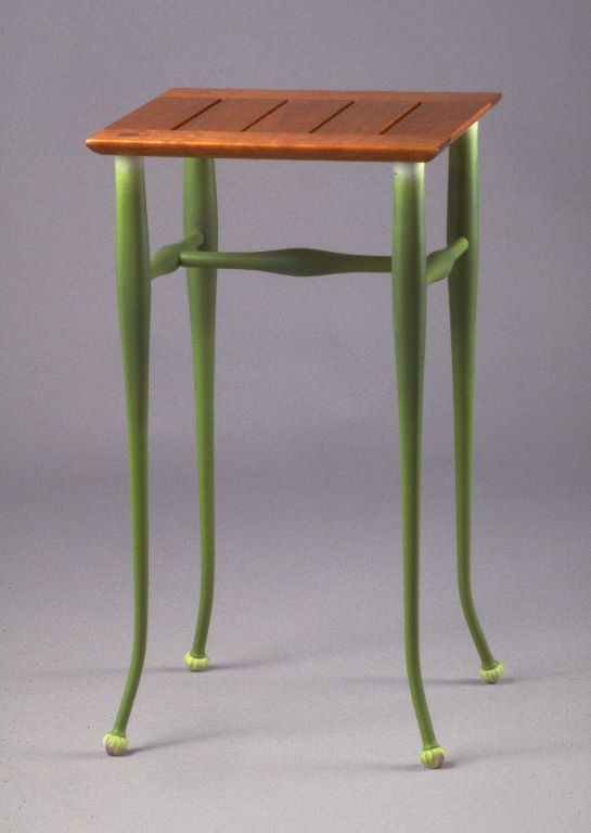 "One of the pieces invited by the Cumberland Furniture Guild's upcoming exhibition on ""Origin and Inspiration"" is this little side table, which features legs and feet inspired by onion blooms."