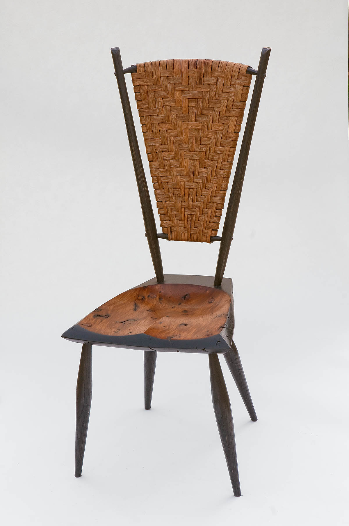 East Tennessee chairmaker Curtis Buchanan was invited to show this bold design, which mixes the Windsor chairs he usually builds with the chairs he teaches as part of the GreenWood Project.