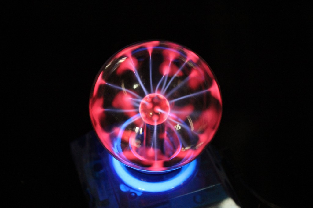 This toy, called a plasma globe, effectively demonstrates electricity build-up in a DIY dust collector.