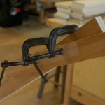 When the case is square, apply a second clamp to the brace to hold it in place while the assembly dries.