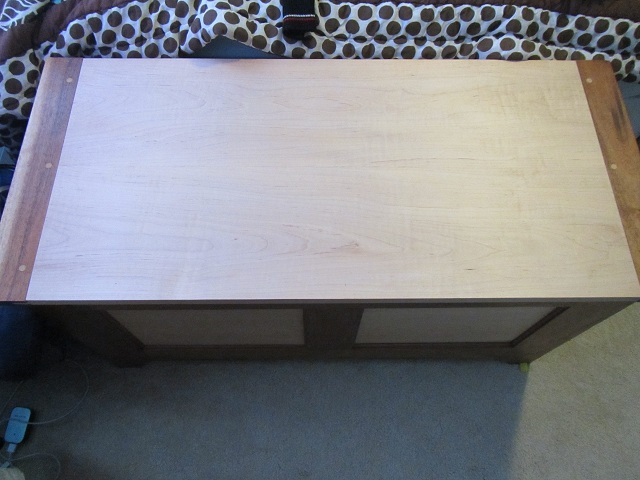 Top view of the hope chest, showing the lid. I chose breadboard ends (rabbet and groove) with contrasting dowels.
